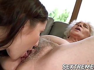 Chubby mature enjoys licking young babe