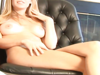 Blondie teasing her muff on office chair